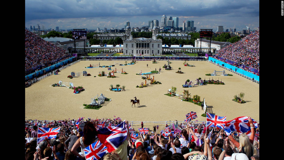 Fans cheer as Scott Brash of Great Britain, riding Hello Sanctos, finishes the third qualifier of individual jumping.