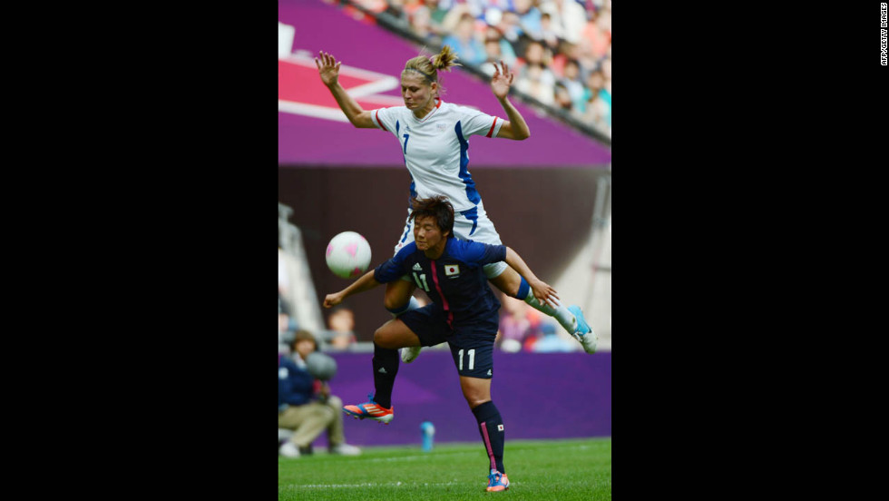 France's Corine Franco, top, vies with Japanese forward Shinobu Ohno during their semifinal match.