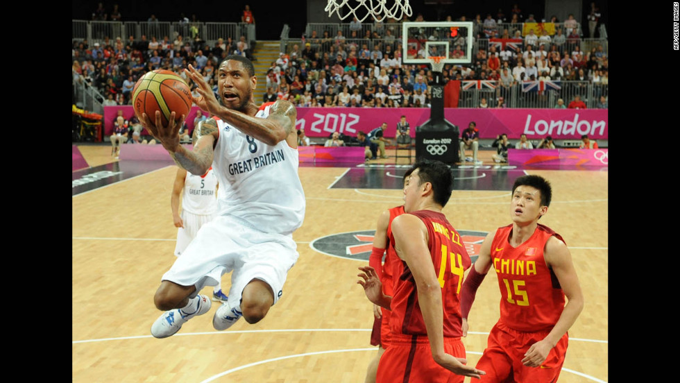 British forward Drew Sullivan, left, jumps to score during the men's basketball preliminary round match between Great Britain and China on Monday, August 6. Great Britain won 90-58.