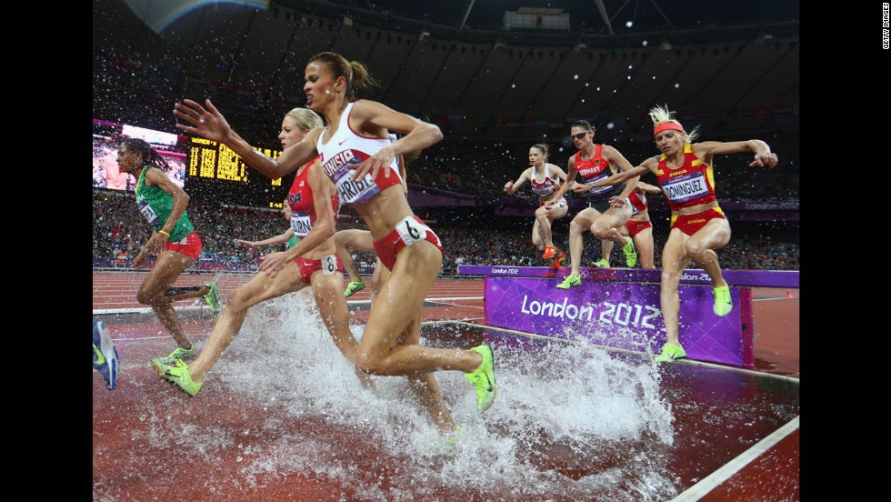 Athletes compete in the women's 3,000-meter steeplechase final.