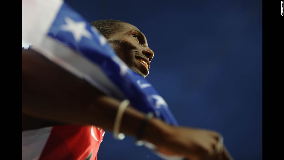 Michael Tinsley of the United States celebrates after winning the silver medal in the men's 400-meter hurdles final.