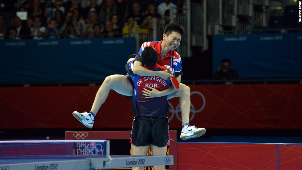 South Korea pair Oh Sangeun and Seungmin Ryu celebrate their team victory over Hong Kong after the men's team table tennis semifinal.