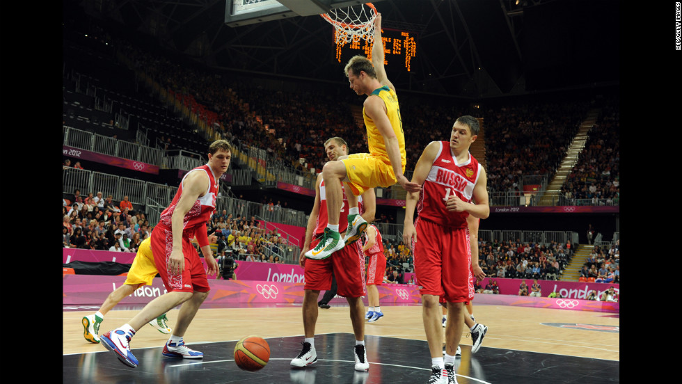 Australian forward Brad Newley scores during the men's basketball preliminary round match against Russia.