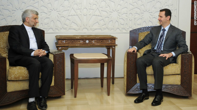 Syrian President al-Assad (R) meets with a top aide to Iran's supreme leader in Damascus on August 7, 2012.