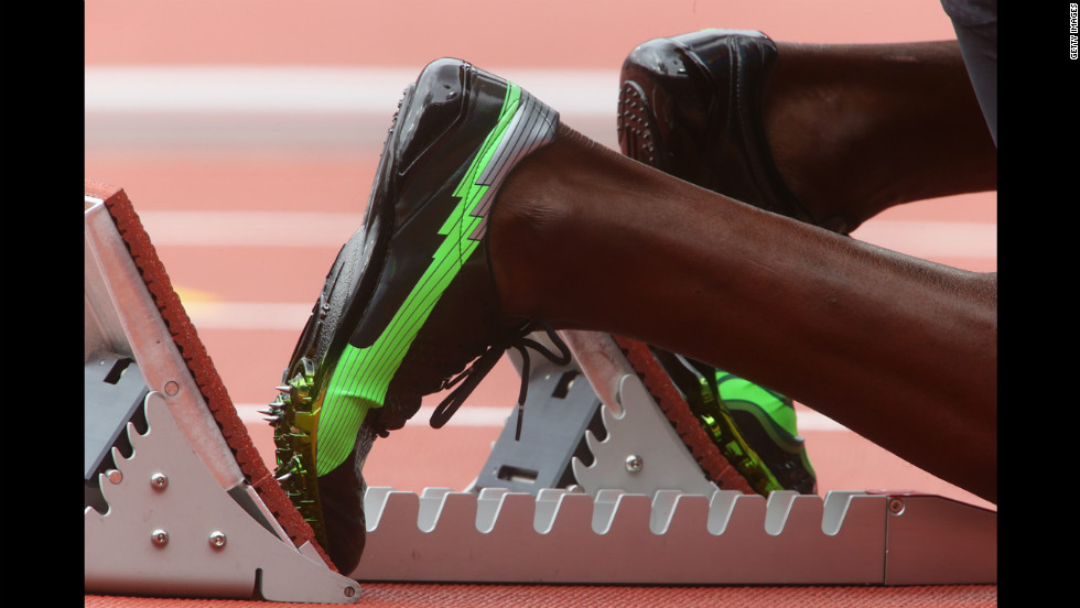 Usain Bolt of Jamaica waits in the starter block prior to the men's 200-meter round 1 heats.
