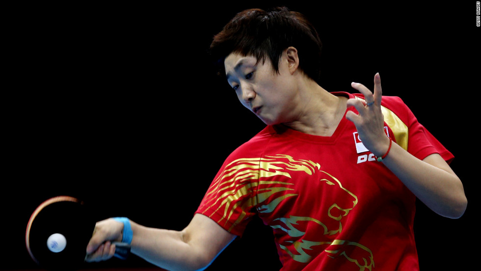Tianwei Feng of Singapore competes in the women's team table tennis bronze medal match.