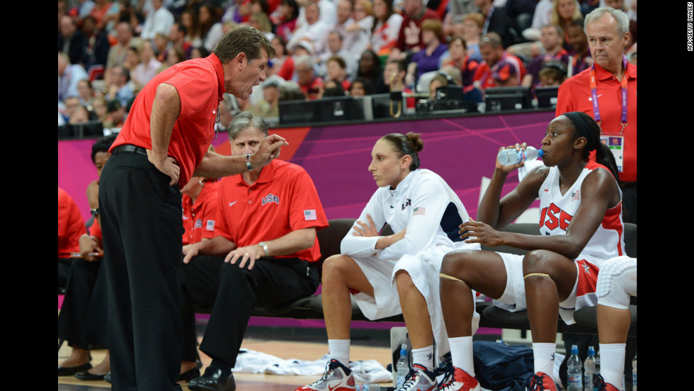U.S. coach Geno Auriemma talks to his players during the women's quarterfinal basketball game against Canada. U.S. defeated Canada 91-48.