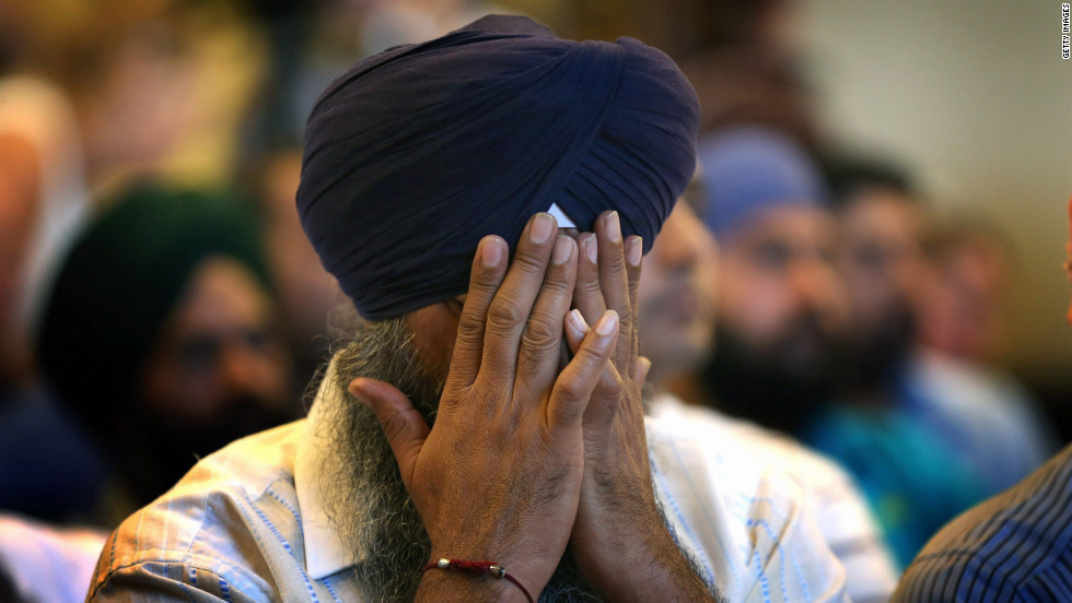 A member of the Miwaukee-area Sikh community weeps as he listens to information about the shooting spree.
