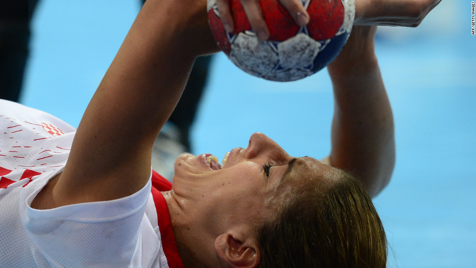 Croatia's right back Andrea Penezic reacts after a fall during the women's quarterfinal handball match against Spain.