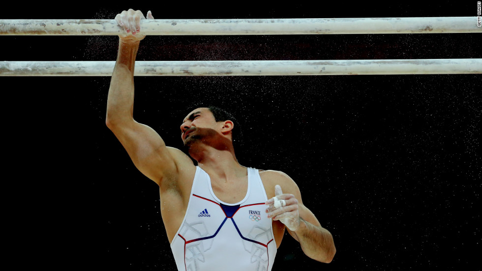French gymnast Hamilton Sabot prepares to compete during the parallel bars final.