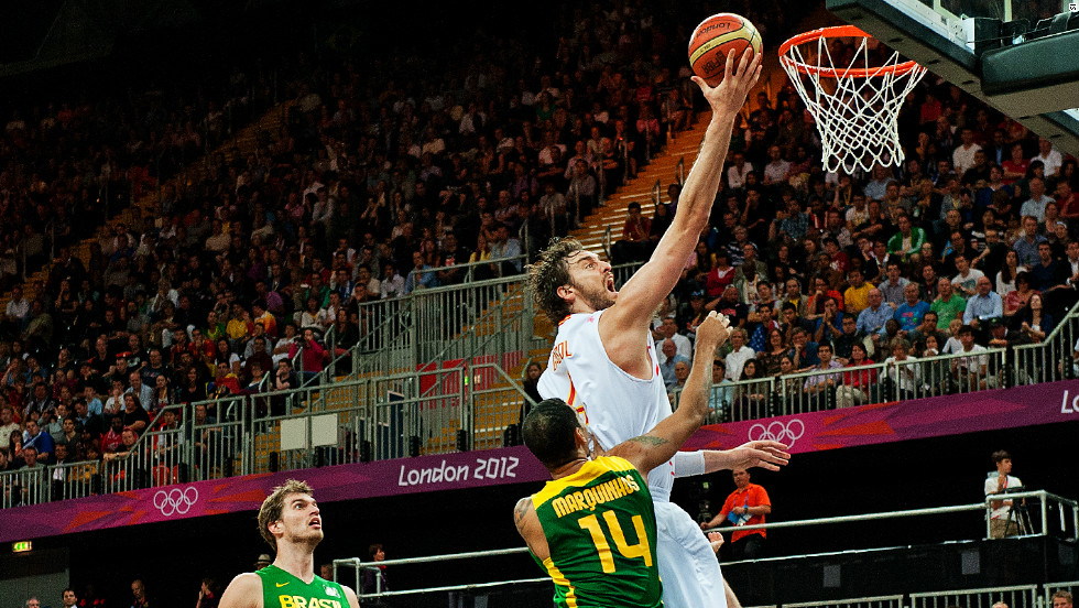 NBA's star Pau Gasol jumps highest during Spain's 88-82 defeat to Brazil in the men's basketball tournament.