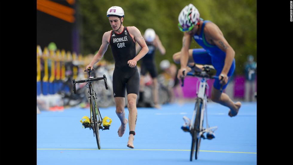 Great Britain's Alistair Brownlee, left, and Italy's Alessandro Fabian compete in the men's triathlon.