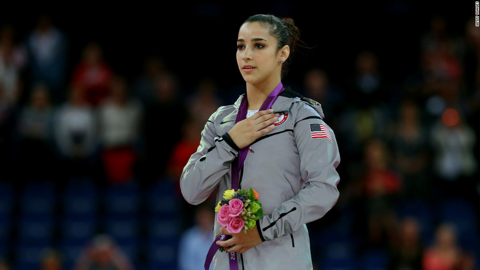Gold medalist Alexandra Raisman poses on the podium during the medal ceremony for the women's gymnastics floor exercise final on Tuesday.