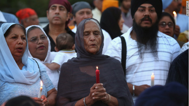 Guests attend a vigil at the Illinois Sikh Community Center on August 6 to honor the victims of the Wisconsin temple massacre