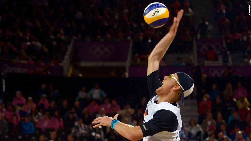 "Germany's Jonas Reckermann serves during the men's beach volleyball semifinal against Reinder Nummerdor and Rich Schuil from Netherlands on Tuesday, August 7.  <a href=""http://www.cnn.com/2012/08/06/worldsport/gallery/olympics-day-ten/index.html"">Check out Day 10 of competition</a> from Monday, August 6. The Games ran through August 12."
