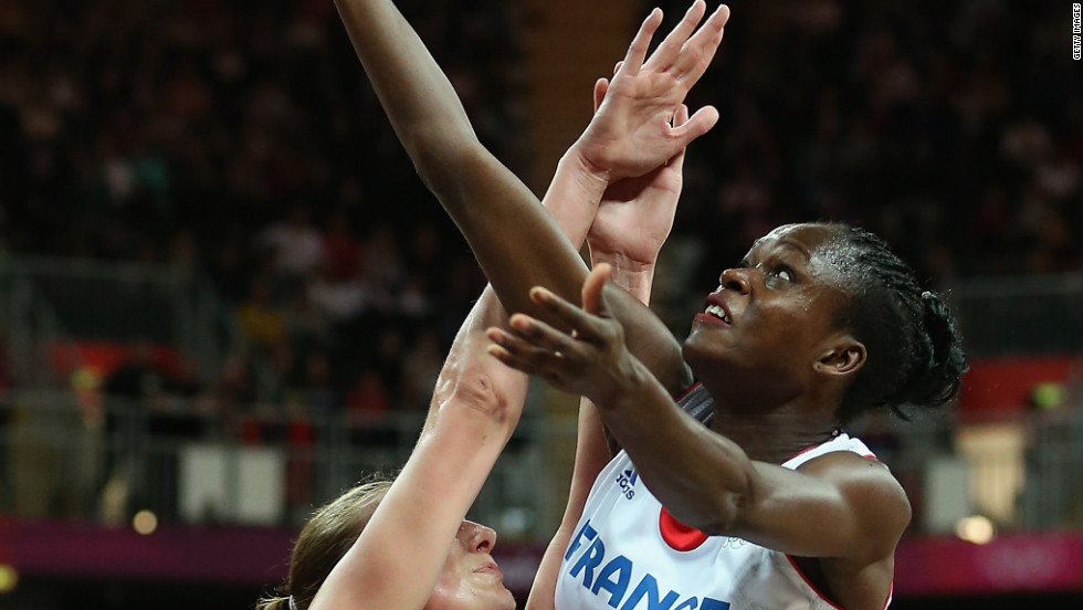 Emilie Gomis, No.11 of France, puts up a shot over Ilona Burgrova, No. 8 of Czech Republic, in the women's basketball quaterfinal.