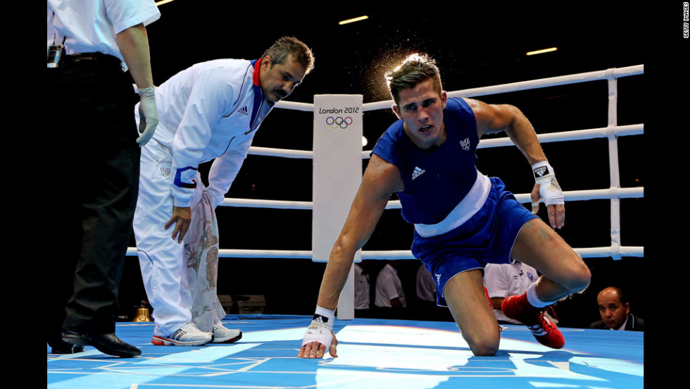 Alexis Vastine of France looks dejected after defeat to Taras Shelestyuk of Ukraine during the men's welter boxing.