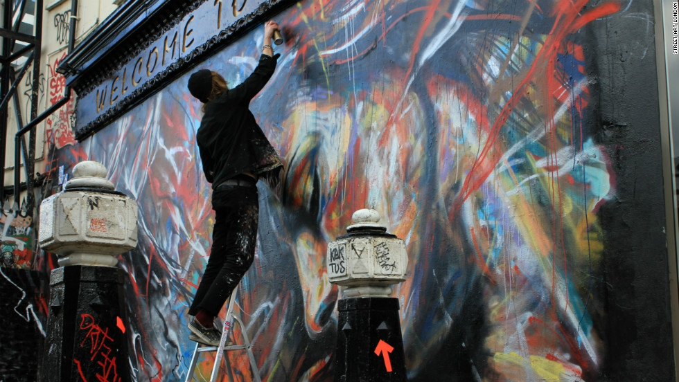 The area around Shoreditch and Brick Lane has become popular with street artists from around the world.  Here is David Walker putting up a piece just off Brick Lane.