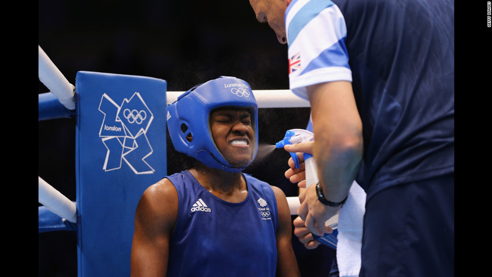 Nicola Adams of Great Britain gets refreshed during the women's fly (51-kilogram) boxing semifinal fight.