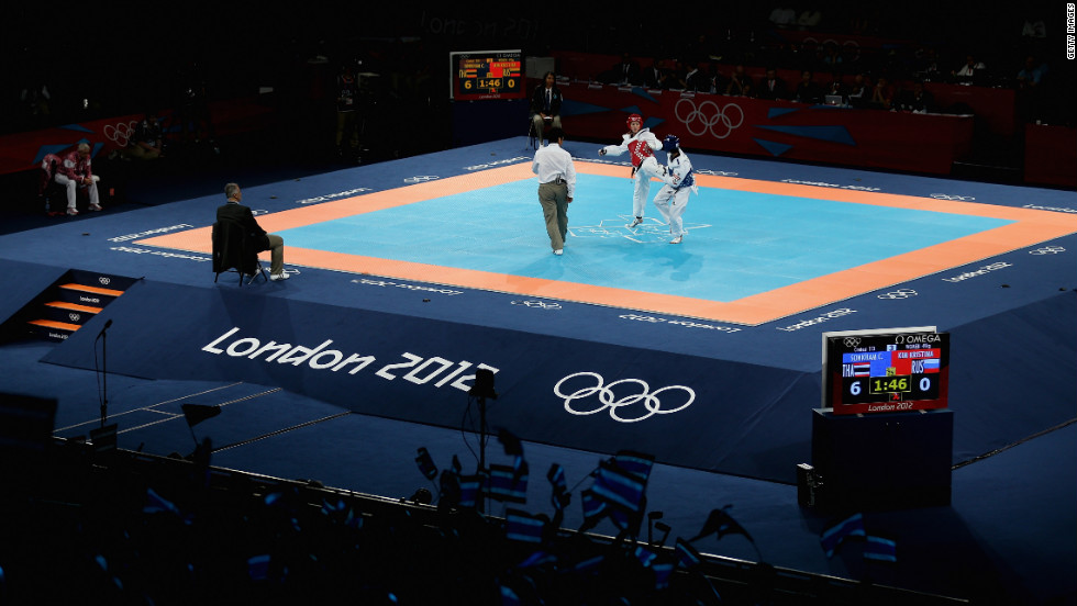 Chanatip Sonkham of Thailand competes against Kristina Kim of Russia during the women's taekwondo under 49-kilogram preliminary match.
