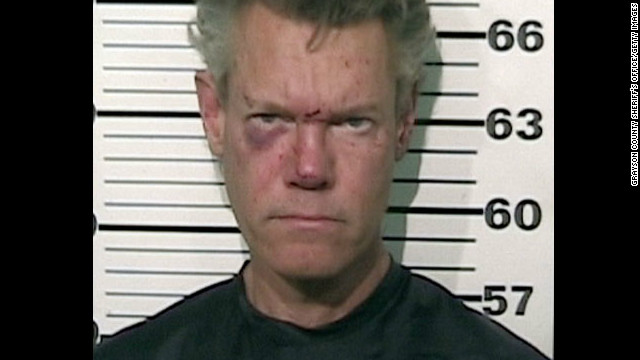 Randy Travis was arrested Tuesday after he was found naked  lying on a roadway in northern Texas and smelling of alcohol.