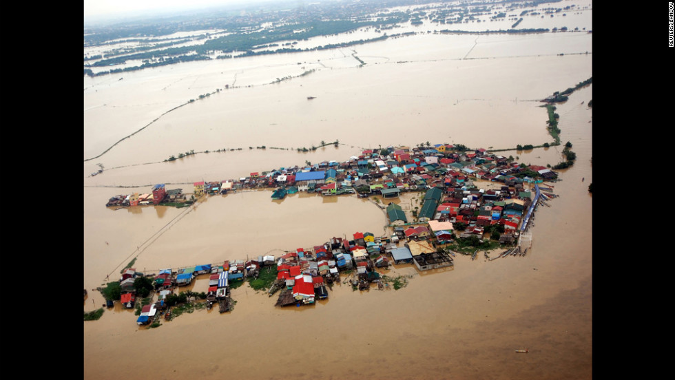Houses swamped by floodwaters in Bulacan province, north of Manila, in an aerial photograph released by the Department of National Defense on Wednesday.