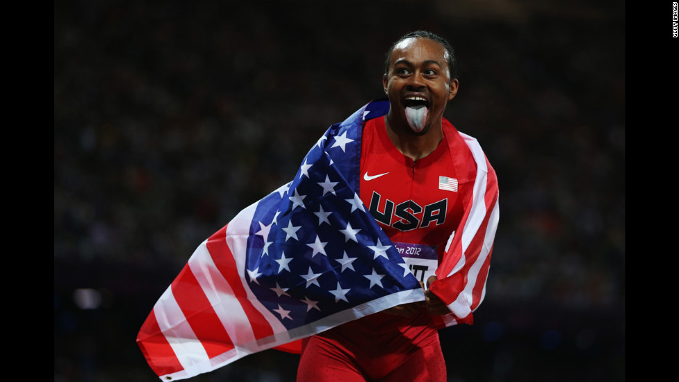 Aries Merritt of the United States celebrates after winning gold in the men's 110-meter hurdles final.