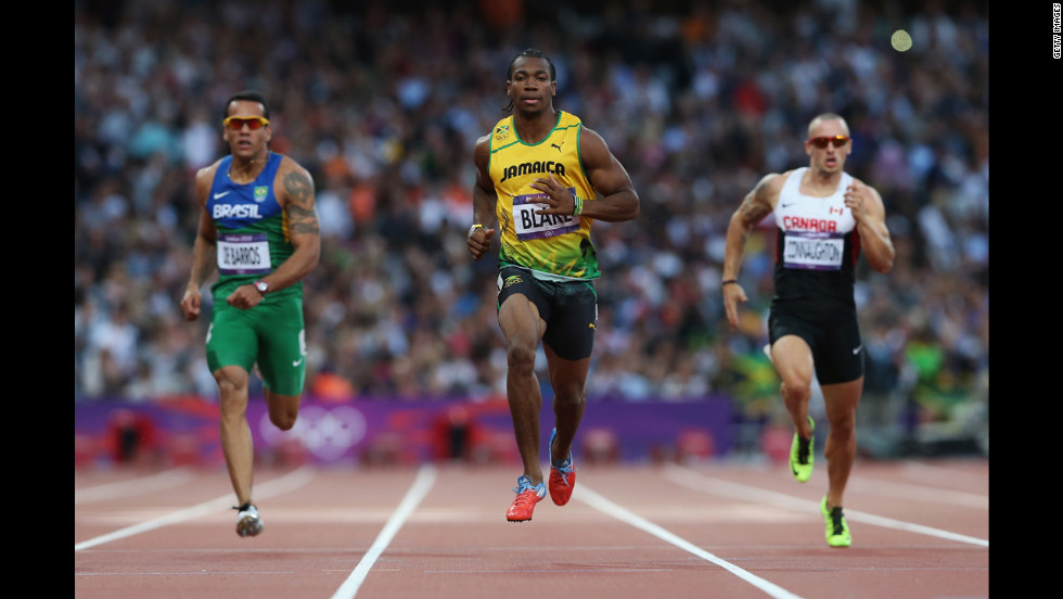 Yohan Blake of Jamaica leads Bruno De Barros of Brazil and Jared Connaughton of Canada in the men's 200-meter semifinals.