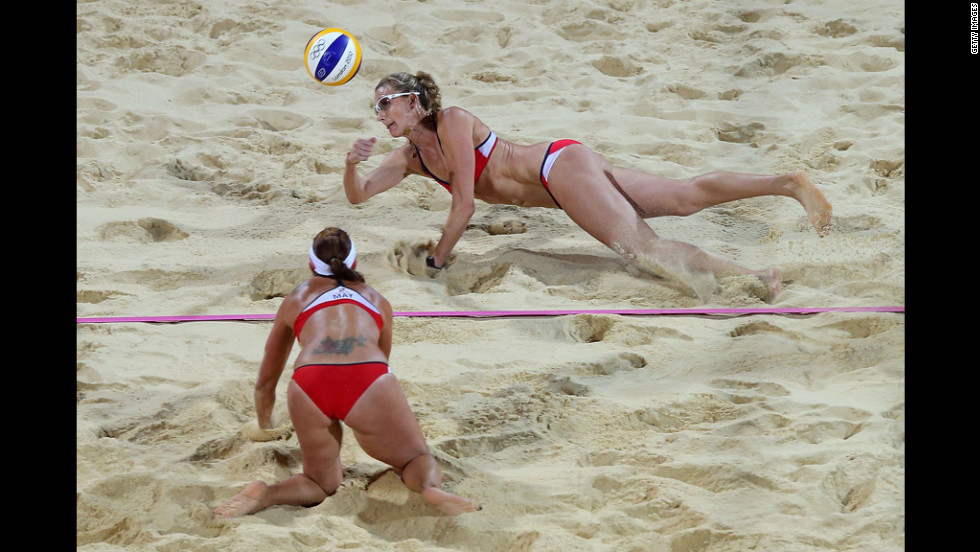 Kerri Walsh Jennings of the United States, top, dives for the ball during the women's beach volleyball gold medal match on Day 12 of the London 2012 Olympic Games at the Horse Guards Parade on Wednesday, August 8. She and teammate Misty May-Treanor were playing another duo of Americans: April Ross and Jennifer Kessy.