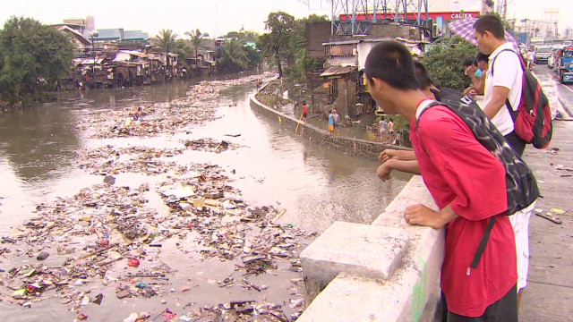 Deadly flooding paralyzes Manila