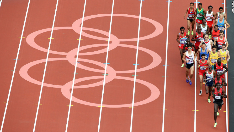 "Athletes compete in round one of the men's 5,000-meter heats at Olympic Stadium. Check out <a href=""http://www.cnn.com/2012/08/09/worldsport/gallery/olympics-day-thirteen/index.html"" target=""_blank"">Day 13 of the competition</a> from Thursday, August 9."