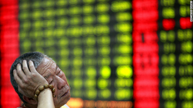 A Chinese stock investor monitors his share prices at a stock brokerage firm in Huaibei, east China's Anhui province on June 4, 2012.
