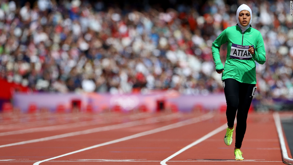 Sarah Attar of Saudi Arabia competes in round one of the women's 800-meter heats at Olympic Stadium.