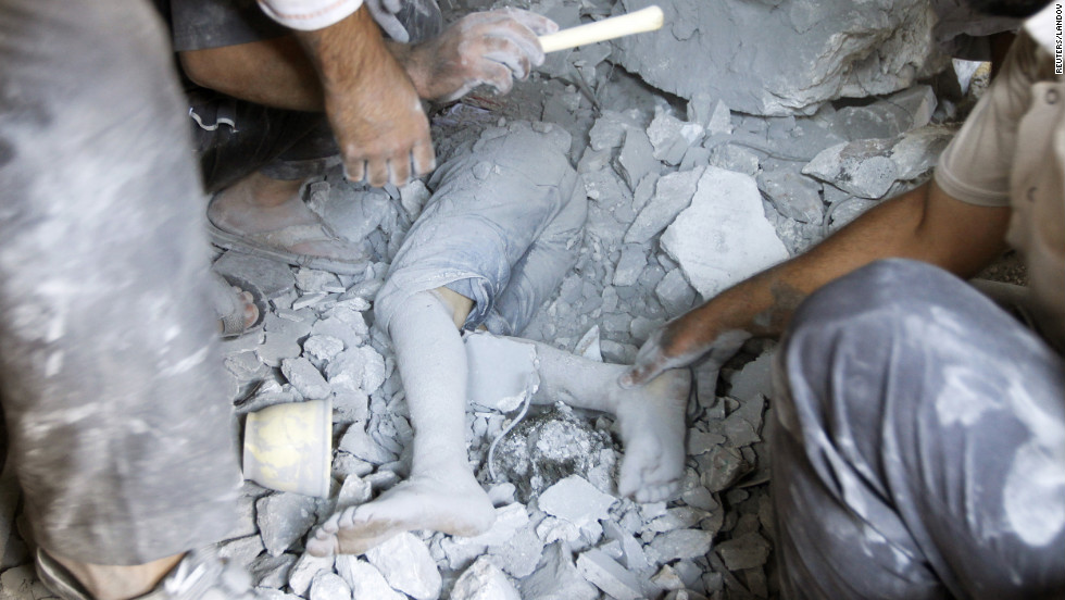 A boy's body is uncovered in the rubble of a house demolished during the recent clashes in Tel Rafat.