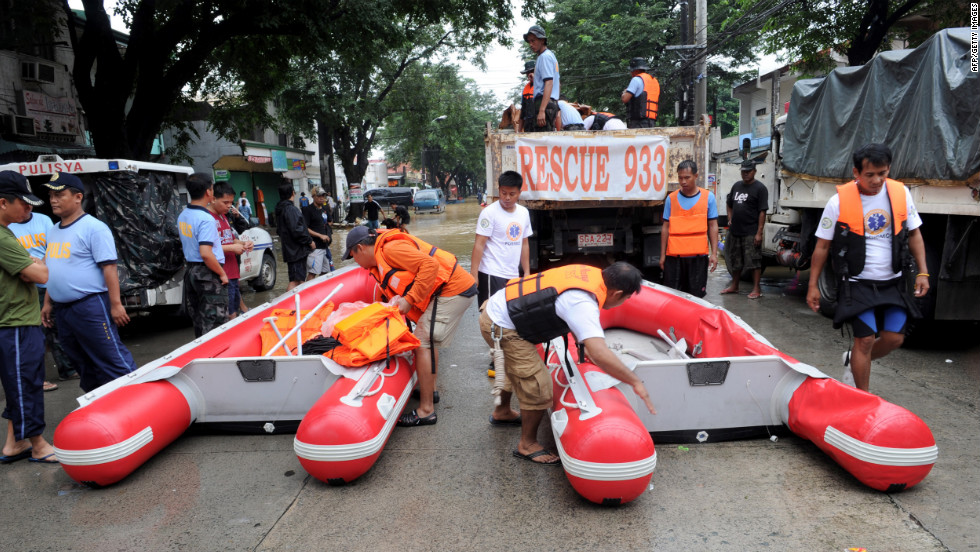 Philippine police rescue teams prepare boats to evacuate residents in a suburb of Manila.