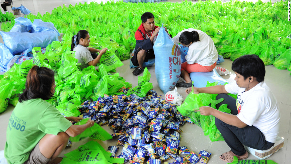 Volunteers bag relief goods for flood victims in Bulacan, north of Manila.
