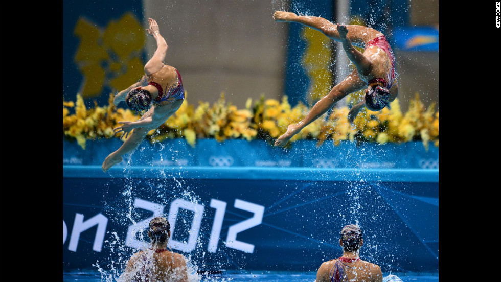 Chinese swimmers compete in the team technical routine during the synchronized swimming competition.