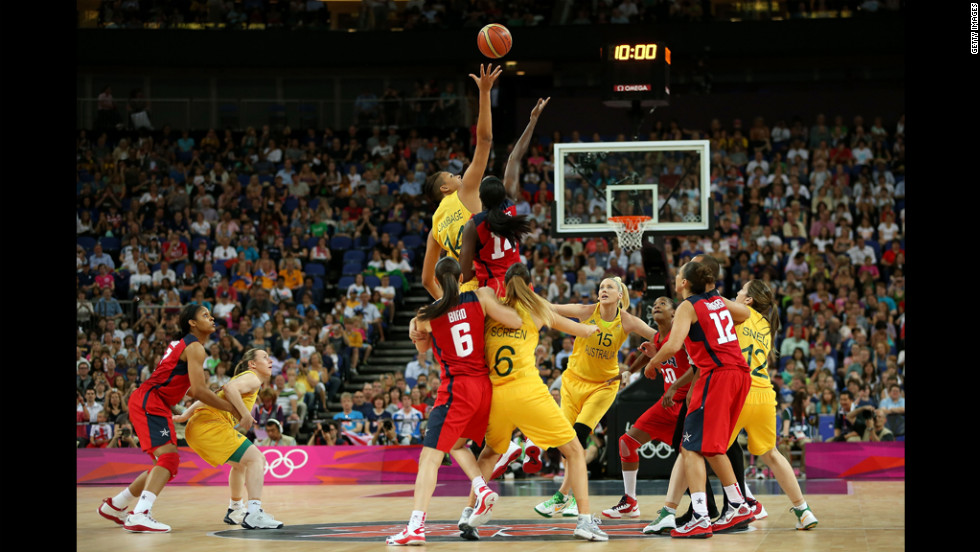 Liz Cambage of Australia attempts to control the opening tipoff against Tina Charles of the United States during the women's basketball semifinal.