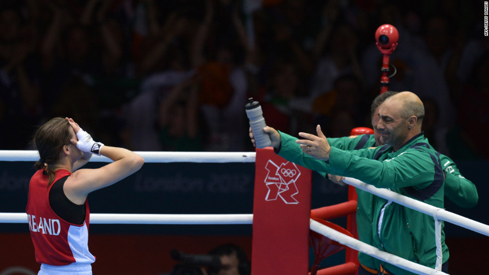 Katie Taylor of Ireland celebrates her defeat of Sofya Ochigava of Russia to win gold during the women's boxing lightweight final.