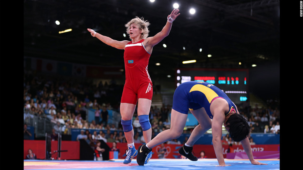 Jiao Wang of China, in blue, and Guzel Manyurova of Kazakhstan compete in the women's freestyle 72-kilogram wrestling.