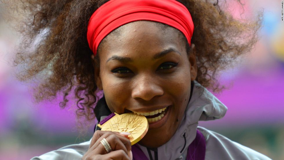 Serena Williams of the U.S. poses on the podium with her gold medal after defeating Russia's Maria Sharapova in the women's singles gold medal match.