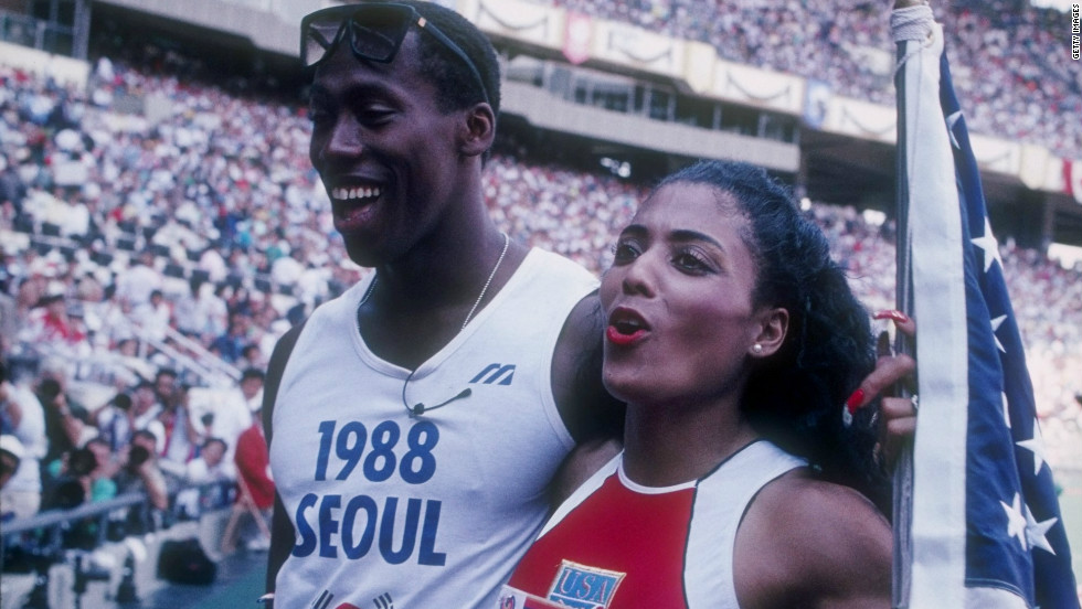 After winning her first gold, she went over to embrace her husband. She would later win the 200 meter final in a world record time. That record also still stands to this day.