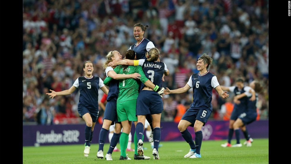 No. 1 Hope Solo, No. 7 Shannon Boxx, No. 3 Christie Rampone, No. 6 Amy LePeilbet and No. 5 Kelley O'Hara of the United States celebrate after defeating Japan by a score of 2-1 to win the women's football gold medal.