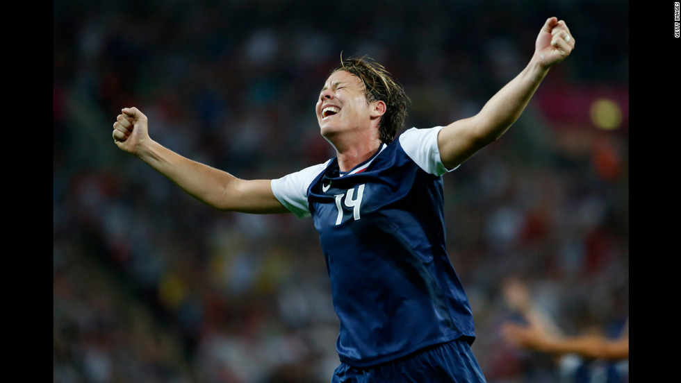 No. 14 Abby Wambach of United States reacts after a goal by No. 10 Carli Lloyd in the second half against Japan during the women's soccer gold medal match.