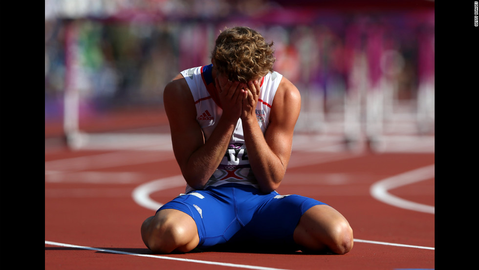 Kevin Mayer of France sits on the track after finishing last in heat 3 of the men's decathlon 110-meter hurdles.