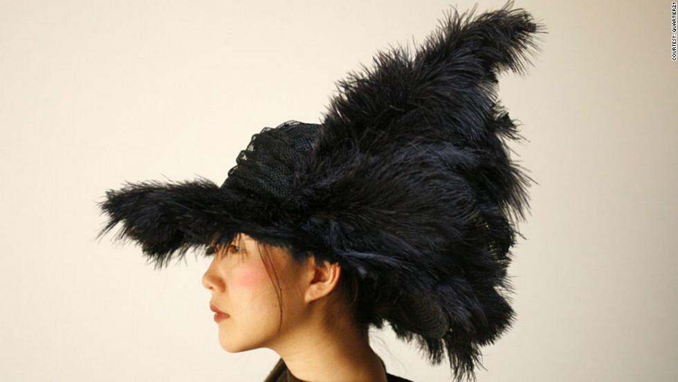 """Taiknam Hat"" is designed to respond to changes in surrounding radio signals. A detection system measures medium-wave radio signals and passes on the information to a microcomputer. The computer then activates motors that move the feathers adorning the hat.  ""Our intention is to ... contribute to our awareness of the increasing level of electromagnetic radiation in our environment,"" say its designers."