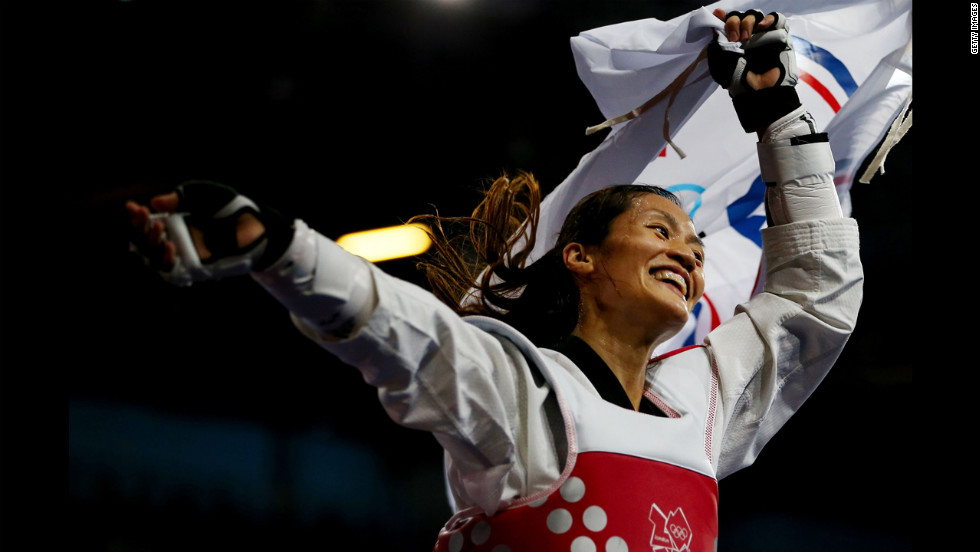 Li-Cheng Tseng of Chinese Taipei celebrates defeating Suvi Mikkonen of Finland during the women's 57 kilogram tae kwon do bronze medal finals.