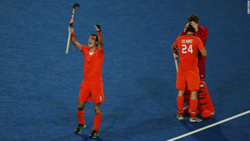 Marcel Balkestein, Robert van der Horst and goalkeeper Jaap Stockman of the Netherlands celebrate victory after the men's hockey semifinal match between Great Britain and the Netherlands.