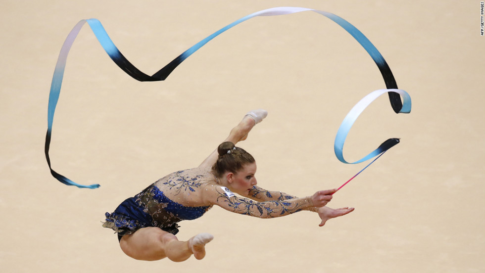 Australia's Janine Murray performs her ribbon program during the individual all-around qualifications of the rhythmic gymnastics event.