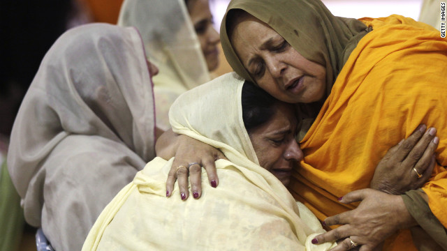 OAK CREEK - AUGUST 10: Two woman hug as community members pay respects to the six victims in the mass shooting at the Sikh Temple of Wisconsin, at the Oak Creek High School August, 10, 2012 Oak Creek Wisconsin. Suspected gunman, 40-year-old Wade Michael Page, allegedly killed six people at the temple on August 5 and then killed himself at the scene. He was an army veteran and reportedly a former member of a white supremacist heavy metal band. Three others were critically wounded in the attack.  (Photo by Darren Hauck/Getty Images)